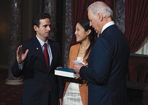 Brian Schatz was sworn into the Senate by Vice President Joe Biden. His wife, Linda, looks on. (MARY CALVERT/Reuters/Newscom)