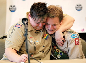Stewart House/Gett Jennifer Tyrrell (left) hugs Pascal Tessier at a news conference in Grapevine, Texas, following the BSA's decision to end its policy of prohibiting openly gay youths from participating in Scout activities.