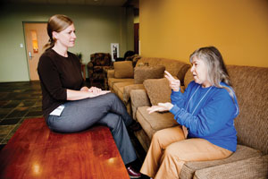 "Betsy ""Bets"" Wohl (right) uses sign language to communicate with  interpreter Christina Healy. (David Stuck)"