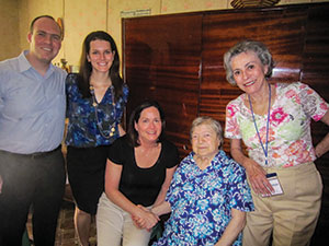 From left: Vadim Kashtelyan, Stephanie Hague, Ellen Goldman and Paula Farbman visit with a homebound Hesed client (center) who relies on The American Jewish Joint  Distribution Committee's  program for health and social
