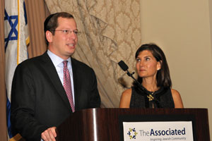 Prior to the annual meeting, Yehuda Neuberger, 2013 chair of the annual campaign, and Judi Fader, 2013 chair of the Women's campaign, reflect on the year's success. (Photos provided)