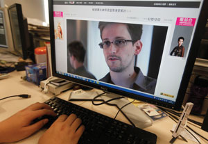 Edward Snowden's revelations have ignited a firestorm of debate on individual privacy versus national security.  (Newscom.com/REUTERS/Jason Lee)