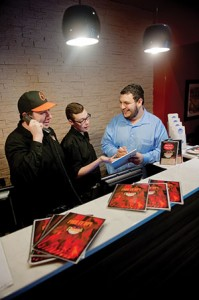 Dougie's owner Tzvi Landau (right) works with employees on a recent dinner shift. Landau, who has a young child, says despite the vigors of the restaurant industry, he strives to achieve a work-life balance.