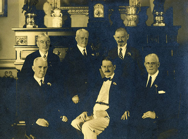 Dr. Harry Friedenwald and a group of fellow physicians pose for their portrait in the 1930s or 1940s