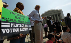 """Supporters of the Voting Rights Act rallied to stop its being struck down. The court voted the act was out of date. One group of Jewish leaders said, """"The court has taken away a safeguard."""" (Win McNamee/Getty Images)"""