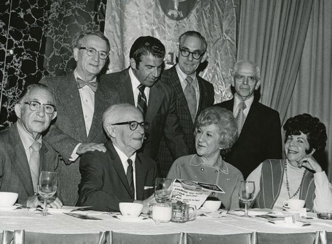 Samuel Neistadt (front row, second from left) is joined by several friends at a formal event.
