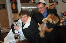 Lee Day (left) celebrates at a recent bark mitzvah.® Day trademarked the name and travels around  the country performing these doggy ceremonies.