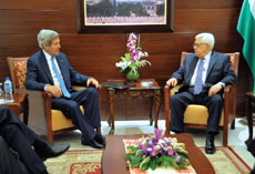 Palestinian Authority President Mahmoud Abbas (right), pictured here with Kerry, brought the 2010 talks to a halt by demanding an extension of settlement building freeze. (Amos Ben Gershom/GPO/Flash90)