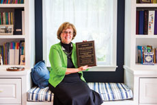 Mary Jo Giulioni proudly displays a plaque that honors her 30 years as a Torah Institute educator. (Justin Tsucalas)