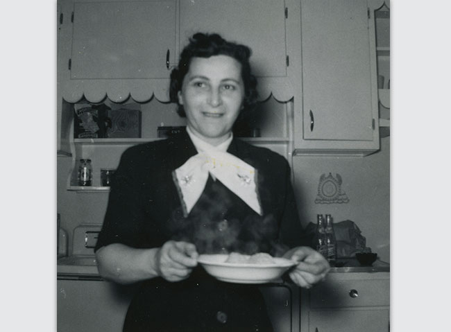 Sadye Goldseker serves matzah ball soup on Passover in 1954.