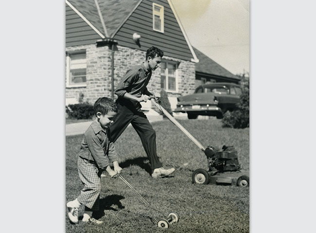 Brothers Leslie Polt, 17, and Gilbert, 4, mow their suburban lawn in 1959. This photo became the face of a recent Jewish Museum of Maryland-Johns Hopkins exhibit.