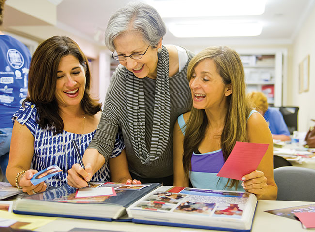 Audrey Polt (center) consults with Jennifer Berman (left) and Lisa Billig during a recent workshop at her home.