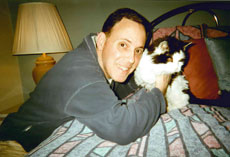 Moses Montefiore Anshe Emunah member Robbie Silverman, pictured with his cat, Sylvester, says the synagogue's pet memorial board will help bring pet owners together. (Provided)
