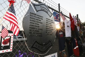 A plaque engraved with names of the 19 fallen firefighters from the Granite Mountain Interagency Hotshot Crew is mounted on a fence outside Station 7, their home base in Prescott, Ariz. Photo: Christian Petersen/Getty Images