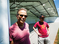 Brad Selko (left) started Hot August Blues and Roots Festival 21 years ago in his backyard. Rich Barnstein (right) helps promote the festival, which now brings around 5,000 people to Oregon Ridge Park each year. (Justin Tsucalas)