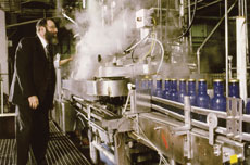 An OU mashgiach offers kosher supervision to a local factory. The OU operates in 50 states and in 80 countries.(Courtesy of the OU)