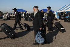 Jews make their way back to Israel from Uman, where they celebrated the Jewish holiday of Rosh Hashanah last year. (Yaakov Nahumi/Flash90)