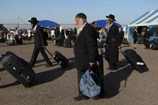 Jews make their way back to Israel from Uman, where they celebrated the Jewish holiday of Rosh Hashanah last year. (Yaakov Nahumi/Flash90)