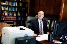 Rabbi Jay R. Goldstein wades through piles of notes to prepare his High Holiday sermon. (Justin Tsucalas)