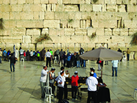 Men pray at the  Western Wall, Judaism's holiest site and the center of an escalating battle over women's prayer restrictions.