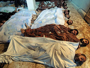 Victims of an alleged chemical attack lie in a makeshift morgue on the outskirts of Damascus. (Photo by Diaa El Din / UPI / Newscom)