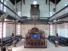 Shaare Shalom Synagogue, with its sand-covered floors, is Jamaica's only shul and has fewer than 200 members.