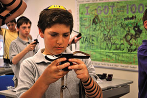 A Beth Tfiloh Dahan Community School student adorns the pair of tefillin he crafted at school. (Photos by David Stuck)