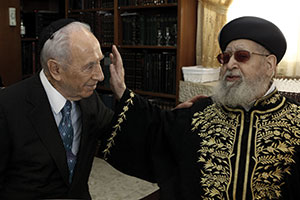 President Shimon Peres met regularly with Rabbi Ovadia Yosef. The president was among those who delivered a  eulogy at the rabbi's funeral on Oct. 7. (Photo by Kobi Gidon/Flash 90)
