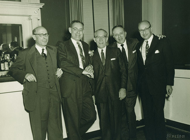 Nathan Ullman, left, Mr. Zamoiski, center, and three unidentified men at the 1956 Annual Convention of the Joseph M. Zamoiski Company, 1956..