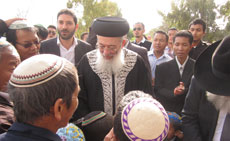 Former Sephardic Chief Rabbi Shlomo Amar greets members of the Bnei Menashe in Givat Haviva, an Israeli absorption center where they will live while undergoing conversion to Judaism.