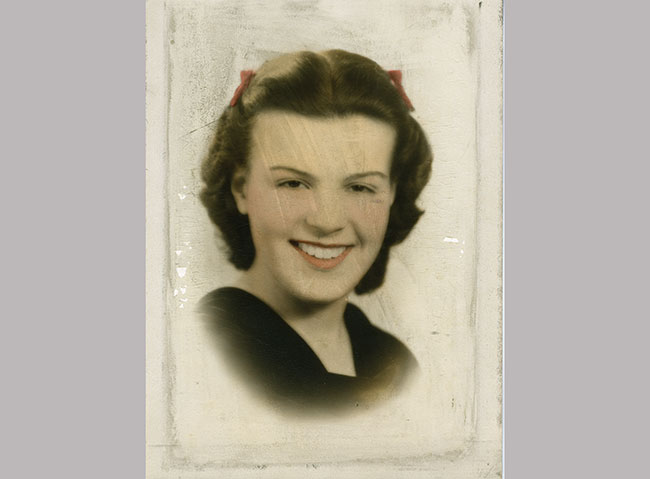 A colorized photograph brings this young woman's smile to life.