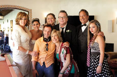 "Bryan Fogel (center), writer, director  and producer of ""Jewtopia,"" poses  with his acting team during filming. (Provided)"