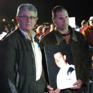 David and Yaron Friedman, holding a picture of Guy, a relative that was murdered by Palestinian terrorists. Source: Tazpit News Agency