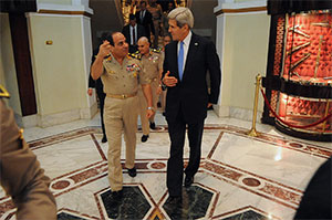 Egyptian Minister of Defense General Abdul Fatah Khalil al-Sisi bids farewell to U.S. Secretary of State John Kerry  earlier this year. (State Department/Public Domain)