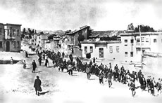 Armenians are marched to a nearby prison in Mezireh by armed Turkish  soldiers in Kharpert, Armenia in April 1915. Ninety-nine years after the  Armenian genocide, one of the most poignant symbols of Armenian  suffering is being held hostage by the White House. (Project SAVE via Wikimedia Commons)