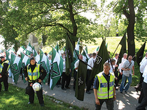 Members of the neo-Nazi organization Swedish Resistance Movement take part in a nationalist demonstration in Stockholm.
