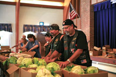 "Carl ""Diesel"" Galler (second from right) and members of Motorcycle Club Five give food to the needy at one of the Community Crisis Center's food giveaways in Reisterstown. (Marc Shapiro)"