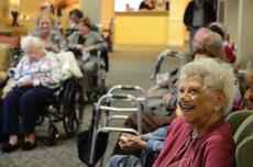Emeritus Senior Living resident Lucille Becker enjoys the Beth Tfiloh Puppeteers' Chanukah show.