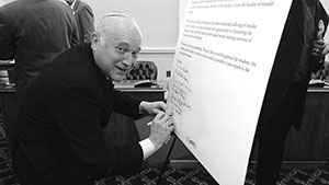 Rabbi Seth Bernstein signs a  letter calling for the end of capital punisment in Maryland. The letter was then circulated through the Maryland General Assembly.
