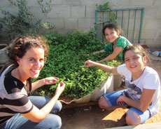 Tali Ruskin, left, volunteers in a Palestinian town. She says her discomfort with the occupation caused her to distance herself from Judaism. When she was better able to separate Judaism and Zionism, that connection returned. (Provided)