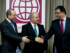 From left: Israeli Regional Development Minister Sylvan Shalom, Jordanian  Water and Agriculture Minister Hazem Nasser and head of the Palestinian Water Authority Shaddad Attili, shake hands after signing an agreement at the World Bank in Washington on Dec. 9. (NICHOLAS KAMM/AFP/Getty Images/Newscom)