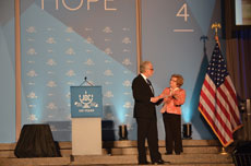 Emcee Wolf Blitzer and Dr. Ruth Westheimer share a JDC memory moment at the JDC centennial event.