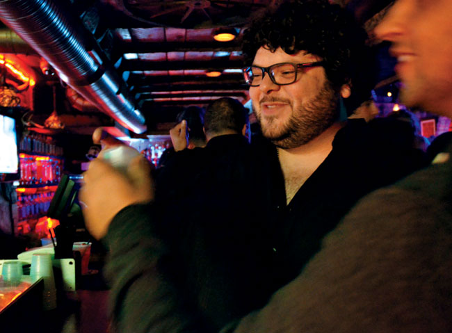 "12:07 a.m. Casey Spigel, owner of Forever Wireless, greets at least a dozen people with hugs and handshakes within 15 minutes of entering The Horse You Came In On Saloon in Fells Point. ""He's like the mayor of Fells Point,"" says Samantha Blumberg, Spigel's friend of many years. Spigel often meets friends here for a mid-work-week break. ""It's a good place for young professionals; it's not judgmental or pretentious. It gets us through the week,"" says Spigel, who seems to share a genuine gift of gab with his parents, Arie and Tsipora. Both are from Israel, but they met in Baltimore when frequenting the Pimlico Diner."
