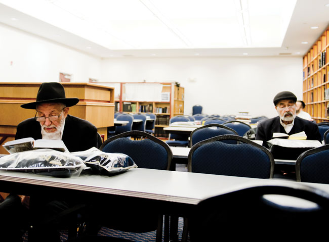 5:30 a.m. Menashe Sadik and several others can be found poring over their Jewish texts in the study hall of Ohr Hamizrach, the local Iranian synagogue. Sadik says he and the others arrive as early as 4:45 a.m. to learn Torah. A holy scene in Jewish Baltimore!