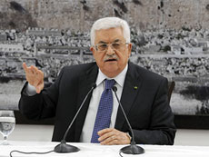 Palestinian Authority President Mahmoud Abbas meets with the media in Ramallah on April 22, a day before his Fatah party signed a reconciliation agreement with Hamas.  (Palestinian Press Office via Getty Images)