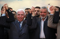 Senior Fatah official Azzam Al-Ahmed (left) and Ismail Haniyeh, head of the Hamas government, announce a reconciliation agreement in Gaza City on April 23. The leaders agreed to form a unity government within five weeks. (Abed Rahim Khatib /Flash90/JNS)