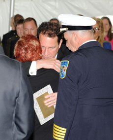 Paulette Ohana, the mother of Gene Kirchner, hugs Baltimore County  Executive Kevin Kamenetz during Fallen Heroes Day ceremonies. (Provided)