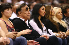Los Angeles Clippers owner Donald Sterling watches a Clippers game with V. Stiviano.  (Ronald Martinez/Getty Images, courtesy of JTA News and Features)
