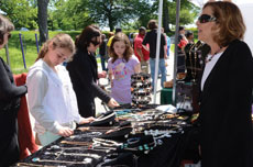Ellen Samet answers questions about her jewelry, Creations by El, at Art Outside in Druid Hill Park. (Melissa Gerr)