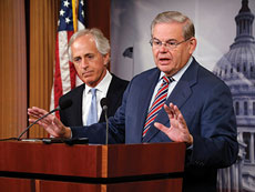 Senate Foreign Relations Committee Chairman Robert Menendez (D-N.J.) (right) and ranking member Sen. Bob Corker (R-Tenn) hold a news conference after a Senate vote on an aid package for Ukraine at the Capitol in Washington. (JONATHAN ERNST/REUTERS/Newscom)
